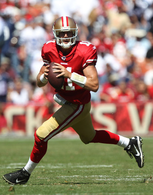 SAN FRANCISCO, CA - SEPTEMBER 18:   Alex Smith #11 of the San Francisco 49ers runs with the ball against the Dallas Cowboys at Candlestick Park on September 18, 2011 in San Francisco, California.  (Photo by Jed Jacobsohn/Getty Images)