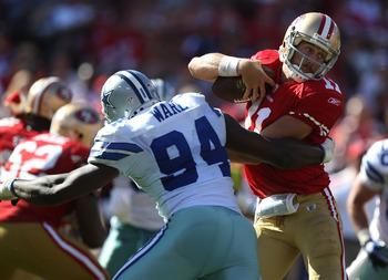 SAN FRANCISCO, CA - SEPTEMBER 18:   Alex Smith #11 of the San Francisco 49ers is sacked by DeMarcus Ware #94 of the Dallas Cowboys at Candlestick Park on September 18, 2011 in San Francisco, California.  (Photo by Jed Jacobsohn/Getty Images)