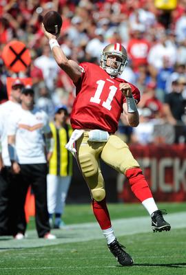 SAN FRANCISCO, CA - SEPTEMBER 18: Alex Smith #11 of the San Francisco 49ers throws a pass into the endzone against the Dallas Cowboys in the second quarter during an NFL football game at Candlestick Park on September 18, 2011 in San Francisco, California.