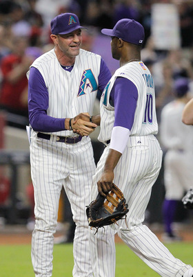 PHOENIX, AZ - SEPTEMBER 09:  Manager Kirk Gibson of the Arizona Diamondbacks congratulates Justin Upton #10 after a 3-2 victory over the San Diego Padres during the MLB game at Chase Field on September 9, 2011 in Phoenix, Arizona.  (Photo by Chris Pondy/G