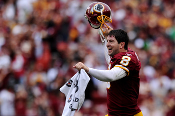 LANDOVER, MD - SEPTEMBER 18: Quarterback Rex Grossman #8 of the Washington Redskins celebrates after a fumble was recovered against the Arizona Cardinals late in the fourth quarter at FedExField on September 18, 2011 in Landover, Maryland. The Washington