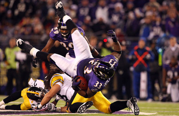 BALTIMORE - DECEMBER 14:  LeRon McClain #33 of the Baltimore Ravens is upended on a run by Troy Polamalu #39 of the Pittsburgh Steelers on December 14, 2008 at M&T Bank Stadium in Baltimore, Maryland. The Steelers defeated the Ravens 13-9.  (Photo by Jim