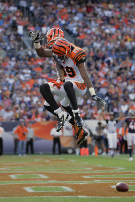 DENVER, CO - SEPTEMBER 18:  Wide receiver Andre Caldwell #87 of the Cincinnati Bengals celebrates his third quarter touchdown with teammate Jerome Simpson #89 of the Cincinnati Bengals against the Denver Broncos at Sports Authority Field at Mile High on S
