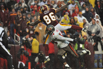 LANDOVER, MD - DECEMBER 12:  Fred Davis #86 of the Washington Redskins can't make this endzone catch with less than a minute remaining while Geno Hayes #54 of the Tampa Bay Buccaneers  defends at FedExField on December 12, 2010 in Landover, Maryland. The