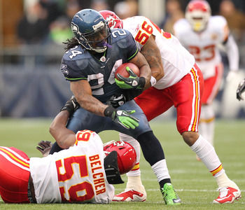 SEATTLE, WA - NOVEMBER 28:  Running back Marshawn Lynch #24 of the Seattle Seahawks is wrapped up by Derrick Johnson #56 and Jovan Belcher #59 of the Kansas City Chiefs at Qwest Field on November 28, 2010 in Seattle, Washington. (Photo by Otto Greule Jr/G