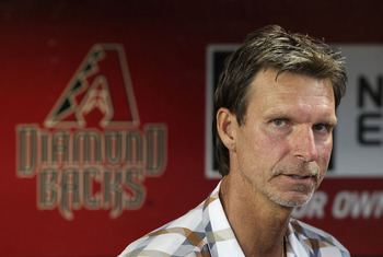 PHOENIX, AZ - SEPTEMBER 10:  Randy Johnson, former member of the 2001 Arizona Diamondbacks World Series team talks stands in the dugout before the Major League Baseball game against the San Diego Padres at Chase Field on September 10, 2011 in Phoenix, Ari
