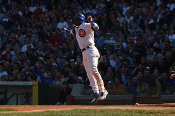CHICAGO - SEPTEMBER 30:  Sammy Sosa #21 of the Chicago Cubs hops after hitting a solo home run in the sixth inning against the Cincinnati Reds during a game on September 30, 2004 at Wrigley Field in Chicago, Illinois. (Photo by Jonathan Daniel/Getty Image