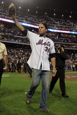 NEW YORK, NY - SEPTEMBER 11:  Former New York Met Mike Piazza waves to the crowd after ceremonies honoring the tenth anniversary of the September 11 2001 terrorist attcks prior to the game between the New York Mets and Chicago Cubs at Citi Field on Septem