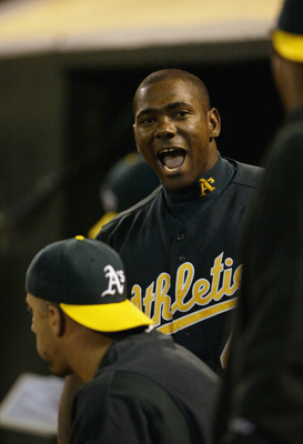 OAKLAND, CA - SEPTEMBER 23:  Short stop Miguel Tejada #4 of the Oakland A's yells from the dugout during the game against the Texas Rangers at the Network Associates Coliseum on September 23, 2003 in Oakland, California.  The Athletics defeated the Ranger