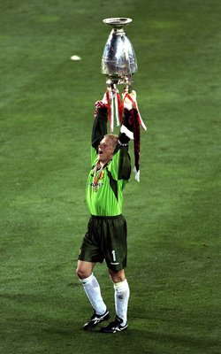 26 May 1999:  Peter Schmeichel of Manchester United holds aloft the European Cup after United beat Bayern Munich in the European Champions League Final in the Nou Camp Stadium, Barcelona, Spain. Manchester United won 2 - 1 with both United goals scored du