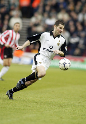 13 Jan 2002:  Denis Irwin of Manchester United looks to break forward during the FA Barclaycard Premiership match against Southampton played at the St Mary's Stadium, in Southampton, England. Manchester United won the match 3-1. DIGITAL IMAGE.Mandatory Cr