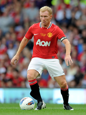 MANCHESTER, ENGLAND - AUGUST 05:  Paul Scholes of Manchester United in action during his Testimonial Match between Manchester United and New York Cosmos at Old Trafford on August 5, 2011 in Manchester, England.  (Photo by Chris Brunskill/Getty Images)