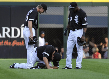 CHICAGO, IL - AUGUST 20: Carlos Quentin #20 of the Chicago White Sox is injured in the first inning catching a ball against the Texas Rangers on August 20, 2011 at U.S. Cellular Field in Chicago, Illinois.  (Photo by David Banks/Getty Images)