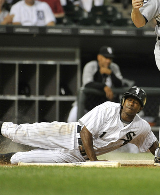 CHICAGO, IL - SEPTEMBER 12:  Juan Pierre #1 of the Chicago White Sox scores past catcher Alex Avila #13 of the Detroit Tigers after Dayan Viciedo #24 hit a ground ball to third base during the first inning at U.S. Cellular Field on September 12, 2011 in C
