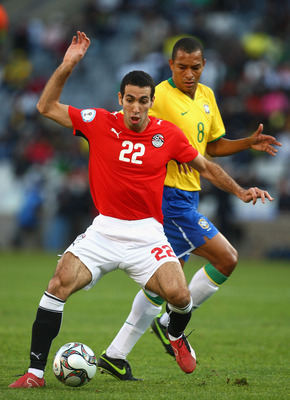 BLOEMFONTEIN, SOUTH AFRICA - JUNE 15: Mohamed Aboutrika of Egypt battles with Gilberto Silva of Brazil during the FIFA Confederations Cup match between Brazil and Egypt at The Free State Stadium on June 15, 2009 in Bloemfontein, South Africa.  (Photo by L