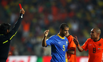 PORT ELIZABETH, SOUTH AFRICA - JULY 02:  Referee Yuichi Nishimura issues a red card to Felipe Melo of Brazil after he stamps on Arjen Robben of the Netherlands during the 2010 FIFA World Cup South Africa Quarter Final match between Netherlands and Brazil