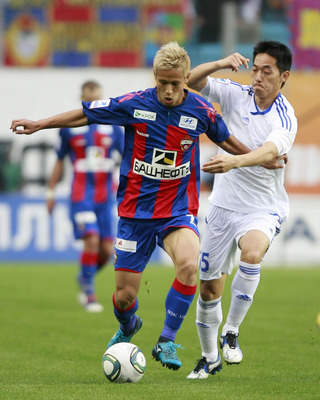 KHIMKI, MOS - AUGUST 20:  Keisuke Honda of FC CSKA Moscow and Kim Nam-Il of FK Tom Tomsk compete for the ball during the Premier League between CSKA Moscow and FK Tom Tomsk  at Arena Khimki on August 20, 2011 in Khimki, Russia.  (Photo by Epsilon/Getty Im