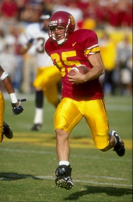 10 Oct 1998:  Petros Papadakis #35 of the USC Trojans carries the ball as he runs during the game against the California Golden Bears at Los Angeles Coliseum in Los Angeles, California. Cailfornia defeated USC 32-31. Mandatory Credit: David Taylor  /Allsp