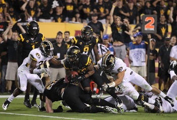TEMPE, AZ - SEPTEMBER 09:  Wide receiver Jamal Miles #32 of the Arizona State Sun Devils scores a 11 yard touchdown reception against the Missouri Tigers during overtime in the college football game at Sun Devil Stadium on September 9, 2011 in Tempe, Ariz