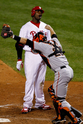PHILADELPHIA - OCTOBER 23:  Ryan Howard #6 of the Philadelphia Phillies strikes out to end the game and lose as Buster Posey #25 of the San Francisco Giants celebrates in Game Six of the NLCS during the 2010 MLB Playoffs at Citizens Bank Park on October 2