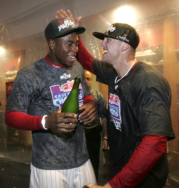 PHILADELPHIA, PA - SEPTEMBER 17: John Mayberry Jr. (L) #15 and Hunter Pence #3 of the Philadelphia Phillies celebrate after the Phillies defeated the St. Louis Cardinals 9-2 to clinch the National League East division championship on September 17, 2011 at