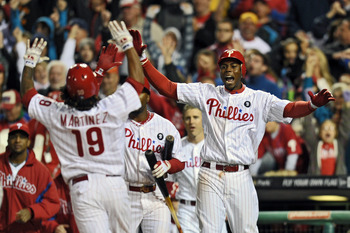 PHILADELPHIA, PA - SEPTEMBER 15: John Mayberry Jr. #15 of the Philadelphia Phillies cheers for teammate Michael Martinez #19 as he crosses home for the game winning run on a Ryan Howard #6 double  during the game against the Florida Marlins at Citizens Ba