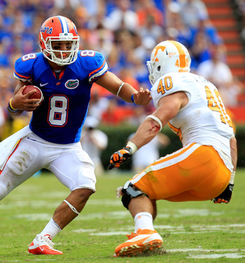 GAINESVILLE, FL - SEPTEMBER 17:  Running back Trey Burton #8 of the Florida Gators runs for yardage against linebacker Austin Johnson #40 of the Tennessee Volunteers during a game at Ben Hill Griffin Stadium on September 17, 2011 in Gainesville, Florida.