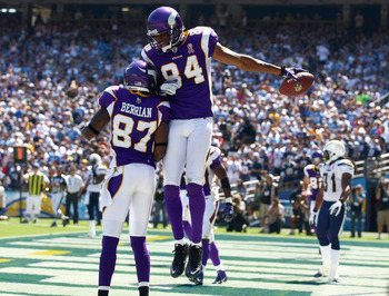 SAN DIEGO, CA - SEPTEMBER 11:  Wide Receiver Michael Jenkins #84 of the Minnesota Vikings celebrates his touchdown catch with teammate Bernard Berrian #87 during the season opener against the San Diego Chargers on September 11, 2011 at Qualcomm Stadium in