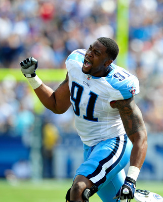 NASHVILLE, TN - SEPTEMBER 18:  Jason Jones #91 of the Tennessee Titans reacts to a defensive stop against the Baltimore Ravens at LP Field on September 18, 2011 in Nashville, Tennessee. Tennessee won 26-13.  (Photo by Grant Halverson/Getty Images)