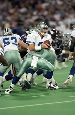 8 Nov 1999:  Troy Aikman #8 of the Dallas Cowboys moves with the ball during the game against the Minnesota Vikings at the Herbert H. Humphery Metrodome in Minneapolis, Minnesota. The Vikings defeated the Cowboys 27-17. Mandatory Credit: Elsa Hasch  /Alls