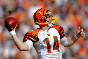 DENVER, CO - SEPTEMBER 18:  Quarterback Andy Dalton #14 of the Cincinnati Bengals throws during the third quarter against the Denver Broncos at Sports Authority Field at Mile High on September 18, 2011 in Denver, Colorado. (Photo by Justin Edmonds/Getty I