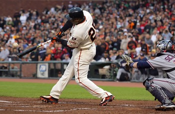 SAN FRANCISCO - AUGUST 08:  Barry Bonds #25 of the San Francisco Giants hits his 757 career homerun in the first inning against the Washington Nationals on August 8, 2007 at AT&T Park in San Francisco, California.  (Photo by Lisa Blumenfeld/Getty Images)