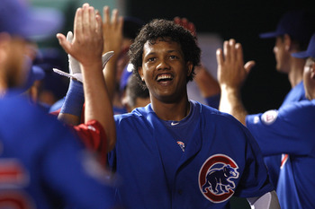 CINCINNATI, OH - SEPTEMBER 12:   Starlin Castro #13 of the Chicago Cubs receives congratulations after scoring during the game against the Cincinnati Reds on September 12, 2011 at Great American Ball Park in Cincinnati, Ohio.  The Cubs defeated the Reds 1