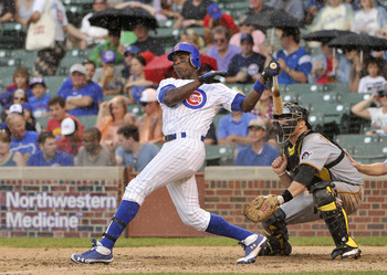 CHICAGO, IL - SEPTEMBER 03:  Alfonso Soriano #12 of the Chicago Cubs follows through on a two-RBI double scoring Aramis Ramirez and Carlos Pena during the seventh inning against the Pittsburgh Pirates at Wrigley Field on September 3, 2011 in Chicago, Illi