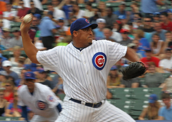 CHICAGO, IL - JULY 16: Starting pitcher Carlos Zambrano #38 of the Chicago Cubs delivers the ball against the Florida Marlins at Wrigley Field on July 16, 2011 in Chicago, Illlinois. (Photo by Jonathan Daniel/Getty Images)