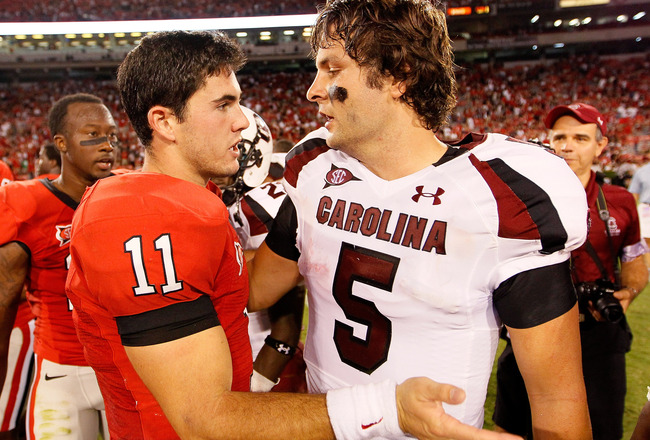ATHENS, GA - SEPTEMBER 10:  Aaron Murray #11 of the Georgia Bulldogs congratulates Stephen Garcia #5 of the South Carolina Gamecocks at Sanford Stadium on September 10, 2011 in Athens, Georgia.  (Photo by Kevin C. Cox/Getty Images)