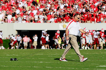 ATHENS, GA - SEPTEMBER 10:  Head coach Mark Richt of the Georgia Bulldogs picks up his playcards after tossing them on the field when the South Carolina Gamecocks scored on a fake punt at Sanford Stadium on September 10, 2011 in Athens, Georgia.  (Photo b