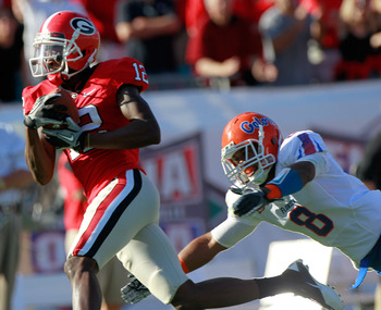 JACKSONVILLE, FL - OCTOBER 30:  Jeremy Brown #8 of the Florida Gators attempts to tackle Tavarres King #12 of the Georgia Bulldogs during the game at EverBank Field on October 30, 2010 in Jacksonville, Florida.  (Photo by Sam Greenwood/Getty Images)