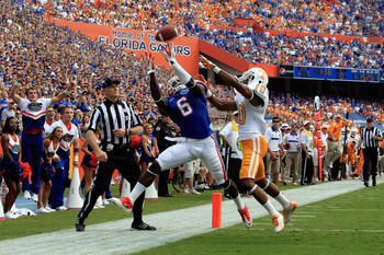 GAINESVILLE, FL - SEPTEMBER 17:  Wide receiver Deonte Thompson #6 of the Florida Gators attempts a catch against defensive back Marsalis Teague #10 of the Tennessee Volunteers during a game at Ben Hill Griffin Stadium on September 17, 2011 in Gainesville,