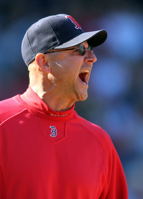 BOSTON, MA - SEPTEMBER 19: Terry Francona #47 of the Boston Red Sox takes issue with umpire Mike Winters #33 and umpire Mike Estabrook #83, ruling a ball hit by David Ortiz #34 of the Boston Red Sox was foul, at Fenway Park September 19, 2011 in Boston, M