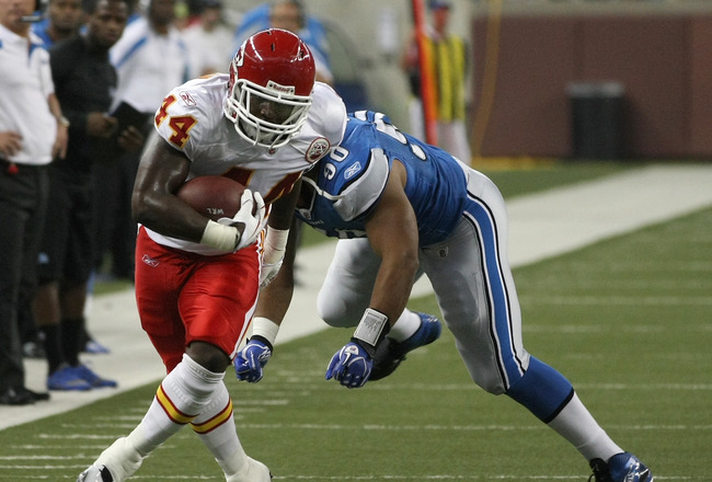 DETROIT, MI - SEPTEMBER 18: Le'Ron McClain #44 of the Kansas City Chiefs runs with the ball as Ndamukong Suh #90 of the Detroit Lions chases at Ford Field on September 18, 2011 in Detroit, Michigan.  (Photo by Dave Reginek/Getty Images)