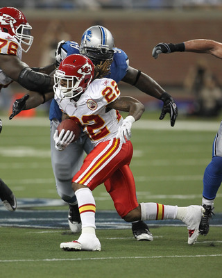 DETROIT, MI - SEPTEMBER 18: Corey Williams #99 of the Detroit Lions tries to tackle Dexter McCluster #22 of the Kansas City Chiefs during a NFL game at Ford Field on September 18, 2011 in Detroit, Michigan.  The Lions won 48-3  (Photo by Dave Reginek/Gett