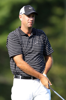 NORTON, MA - SEPTEMBER 03:  Stewart Cink watches his appraoch shot on the 13th hole during the second round of the Deutsche Bank Championship at TPC Boston on September 3, 2011 in Norton, Massachusetts.  (Photo by Jim Rogash/Getty Images)