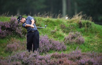 HILVERSUM, NETHERLANDS - SEPTEMBER 09:  Louis Oosthuizen of South Africa plays a shot during the continuation of the delayed first round of The KLM Open Golf at The Hillversumsche Golf Club on September 9, 2011 in Hilversum, Netherlands.  (Photo by Stuart