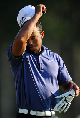 JOHNS CREEK, GA - AUGUST 12:  Tiger Woods wipes his face during the second round of the 93rd PGA Championship at the Atlanta Athletic Club on August 12, 2011 in Johns Creek, Georgia.  (Photo by Stuart Franklin/Getty Images)