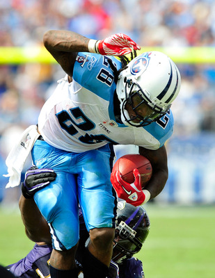 NASHVILLE, TN - SEPTEMBER 18:  Terrell Suggs #55 of the Baltimore Ravens tackles Chris Johnson #28 f the Tennessee Titans  at LP Field on September 18, 2011 in Nashville, Tennessee. Tennessee won 26-13.  (Photo by Grant Halverson/Getty Images)