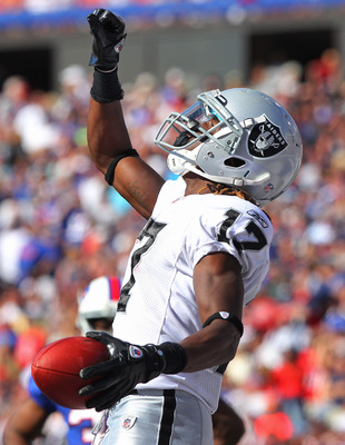 ORCHARD PARK, NY - SEPTEMBER 18: Denarius Moore #17 of the Oakland Raiders celebrates his 4th quarter touchdown during an NFL game against the Buffalo Bills at Ralph Wilson Stadium on September 18, 2011 in Orchard Park, New York. (Photo by Tom Szczerbowsk