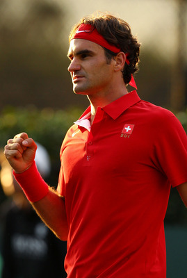 SYDNEY, AUSTRALIA - SEPTEMBER 16: Roger Federer of Switzerland  celebrates winning  his Davis Cup World Group Playoff Tie match against Lleyton Hewitt of Australia at Royal Sydney Golf Club on September 16, 2011 in Sydney, Australia.  (Photo by Mark Nolan