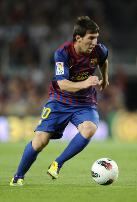 BARCELONA, SPAIN - SEPTEMBER 17:  Lionel Messi of FC Barcelona runs with the ball during the La Liga soccer match between FC Barcelona and CA Osasuna at Camp Nou Stadium on September 17, 2011 in Barcelona, Spain. FC Barcelona won 8-0 and Lionel Messi scor