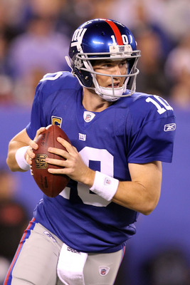 EAST RUTHERFORD, NJ - SEPTEMBER 19:  Eli Manning #10 of the New York Giants looks to pass against the St. Louis Rams at MetLife Stadium on September 19, 2011 in East Rutherford, New Jersey.  (Photo by Al Bello/Getty Images)